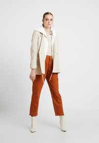 JDY - JDYCALLIE WORKER - Trousers - sugar almond - 1