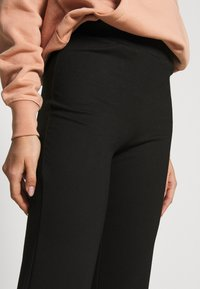 JDY - JDYPRETTY FLARE PANT - Trousers - black - 4