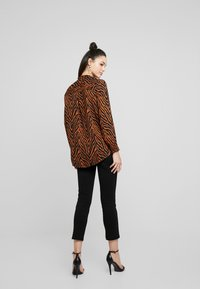 JDY - JDYSNAKEY PLACKET - Overhemdblouse - sugar almond/black