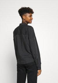 JDY - Skjorte - black/cloud dancer stripe - 2