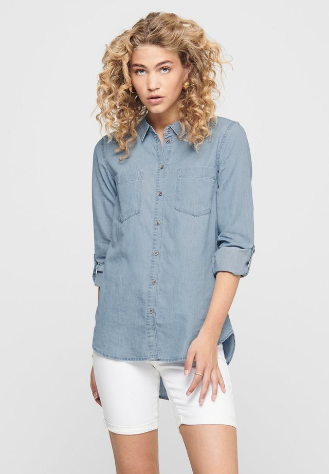 JDYROGER  - Button-down blouse - light blue denim