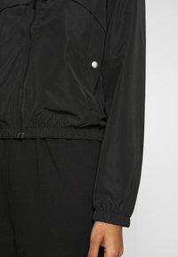 JDY - JDYREACH HOOD JACKET TREATS  - Lehká bunda - black - 4