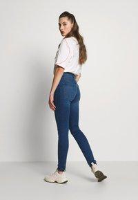 JDY - JDYPOLLI HIGH SUPER - Jeansy Skinny Fit - medium blue denim - 2