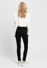 JDY - JONA - Jeans Skinny Fit - black denim - 2
