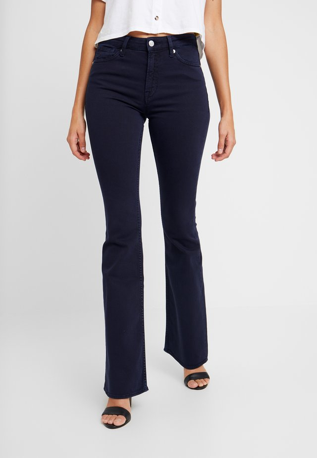 MARIE - Flared jeans - navy