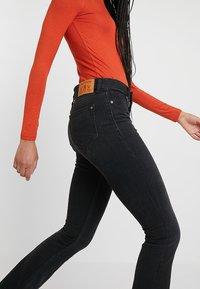 Kings Of Indigo - MARIE - Flared Jeans - black worn - 3