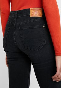 Kings Of Indigo - MARIE - Flared Jeans - black worn - 5