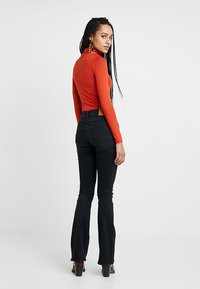 Kings Of Indigo - MARIE - Flared Jeans - black worn - 2