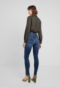 Kings Of Indigo - CHRISTINA HIGH - Jeansy Skinny Fit - dark-blue denim - 3