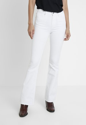 MARIE - Flared Jeans - white
