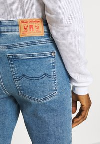 Kings Of Indigo - JUNO HIGH - Jeans Slim Fit - light-blue denim - 5
