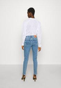 Kings Of Indigo - JUNO HIGH - Jeans Slim Fit - light-blue denim - 2