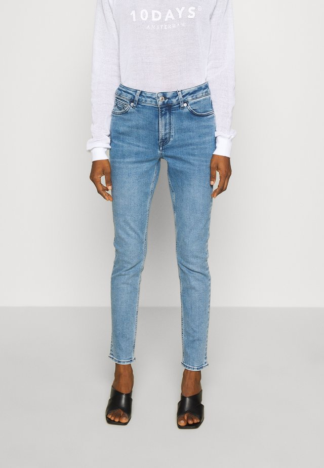 JUNO HIGH - Slim fit jeans - light-blue denim