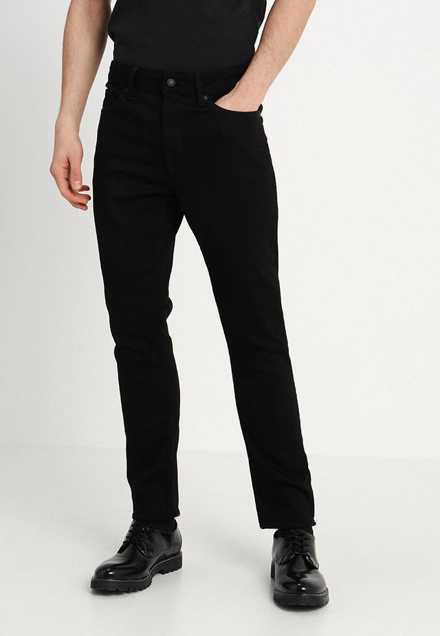 DANIEL - Relaxed fit jeans - stay black