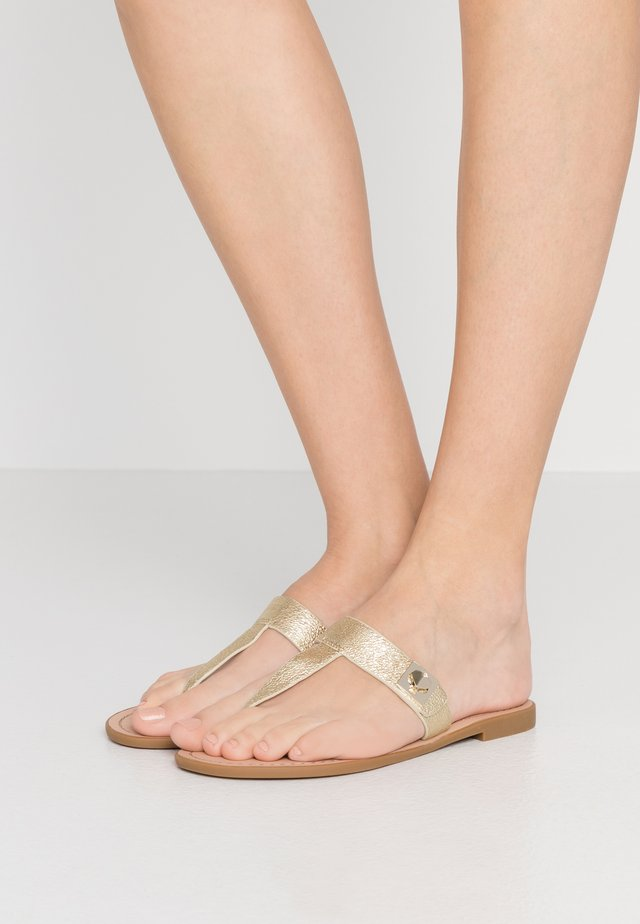 CATANIA - T-bar sandals - pale gold