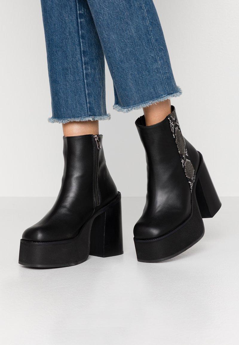 Kaltur - Ankelboots med høye hæler - black