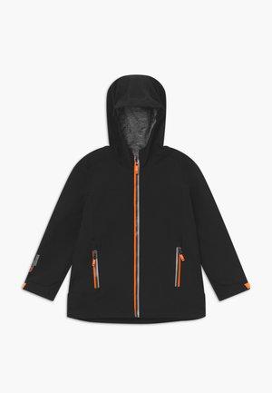 ADJERO - Softshellová bunda - black