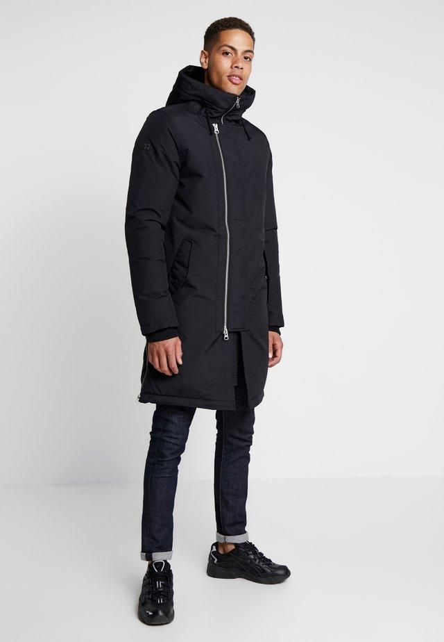GROUND - Kabát zprachového peří - black