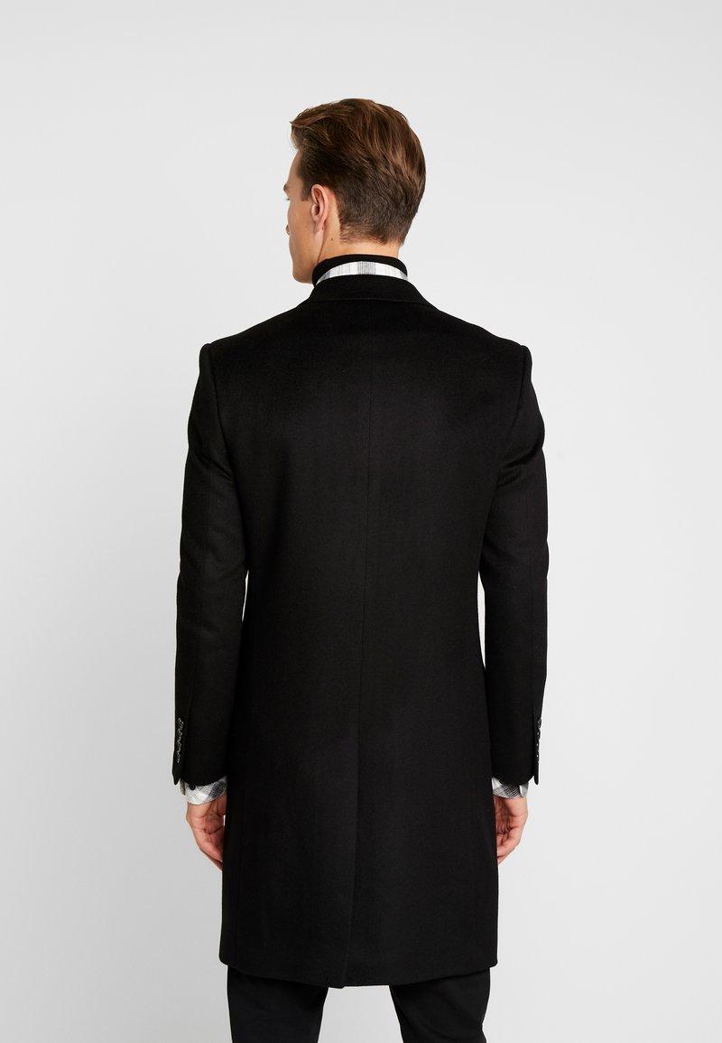 Kartell   Classic Coat by Serge Pariente