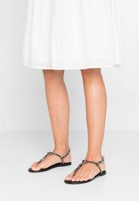 KIOMI - Sandály s odděleným palcem - black - 0