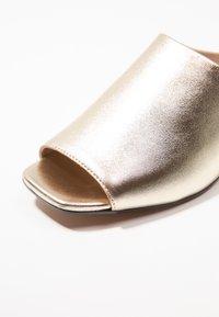 KIOMI - Mules - gold - 2