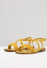 KIOMI - Sandaalit nilkkaremmillä - yellow - 4