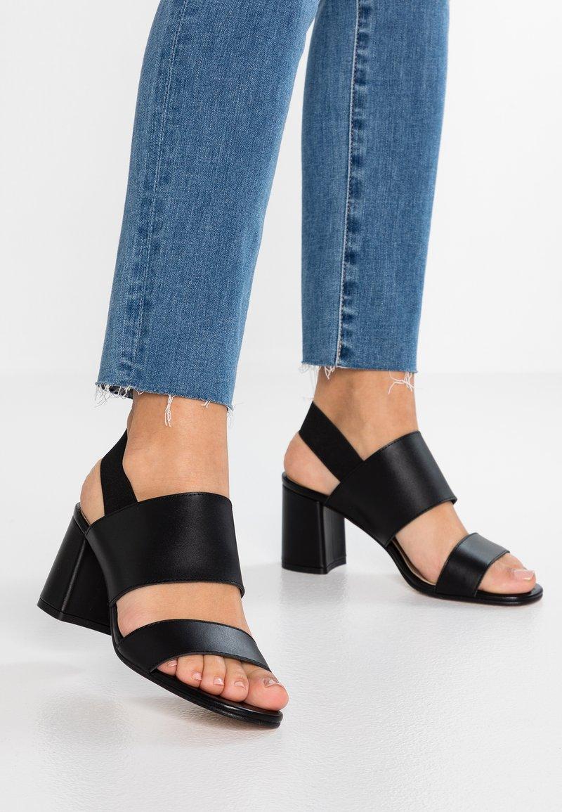 KIOMI - Sandals - black