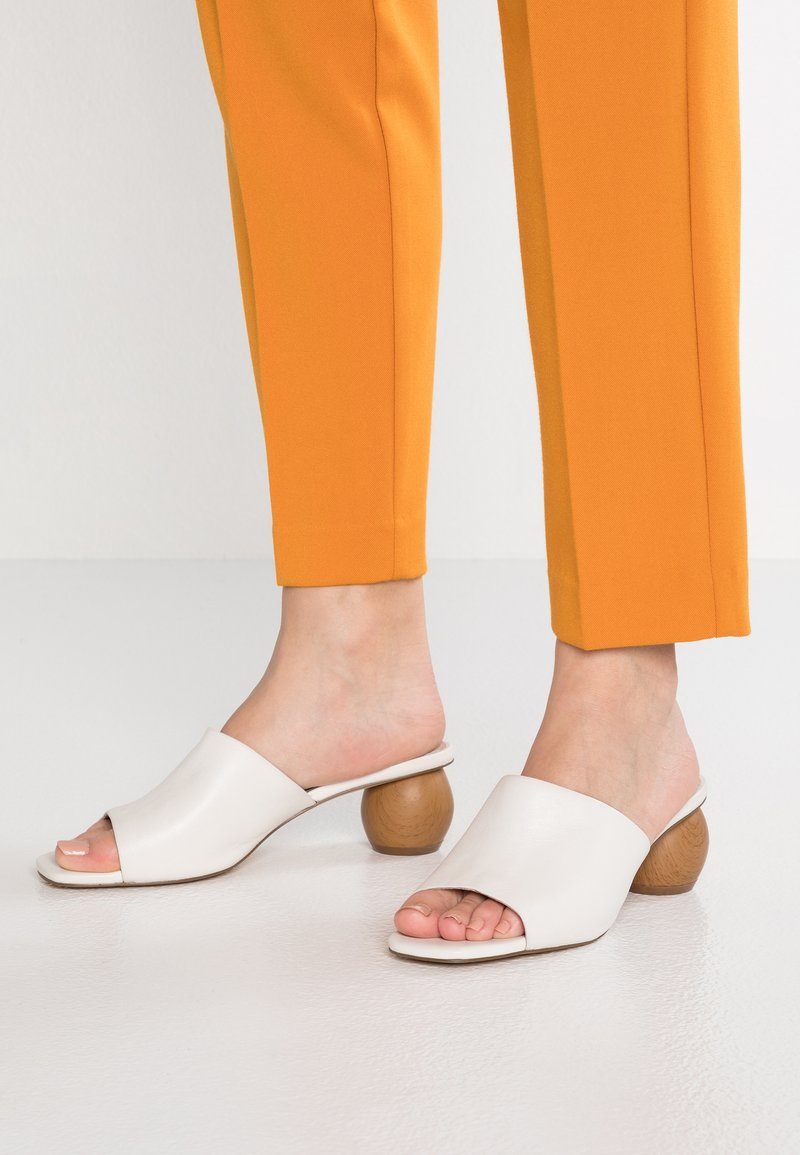 KIOMI - Heeled mules - white