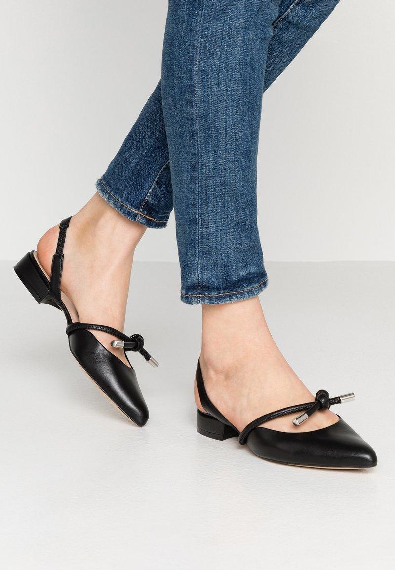 KIOMI - Slingback ballet pumps - black