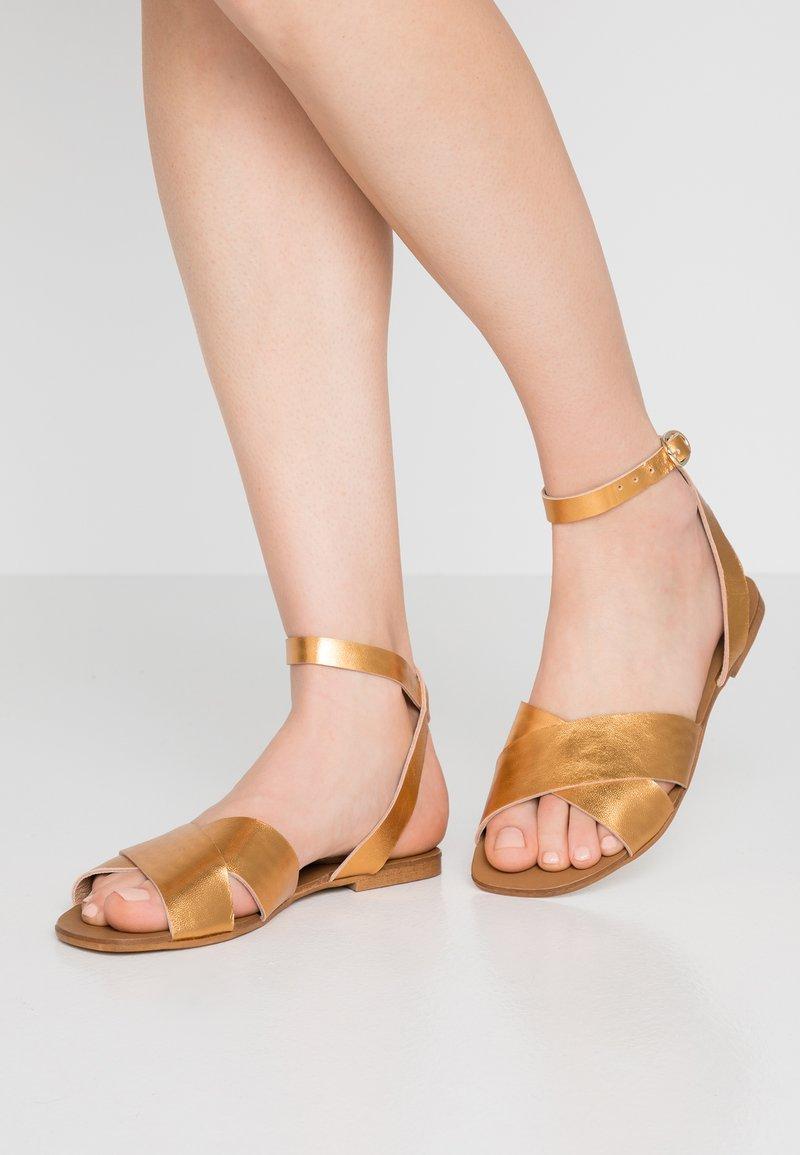 KIOMI - Sandals - bronze