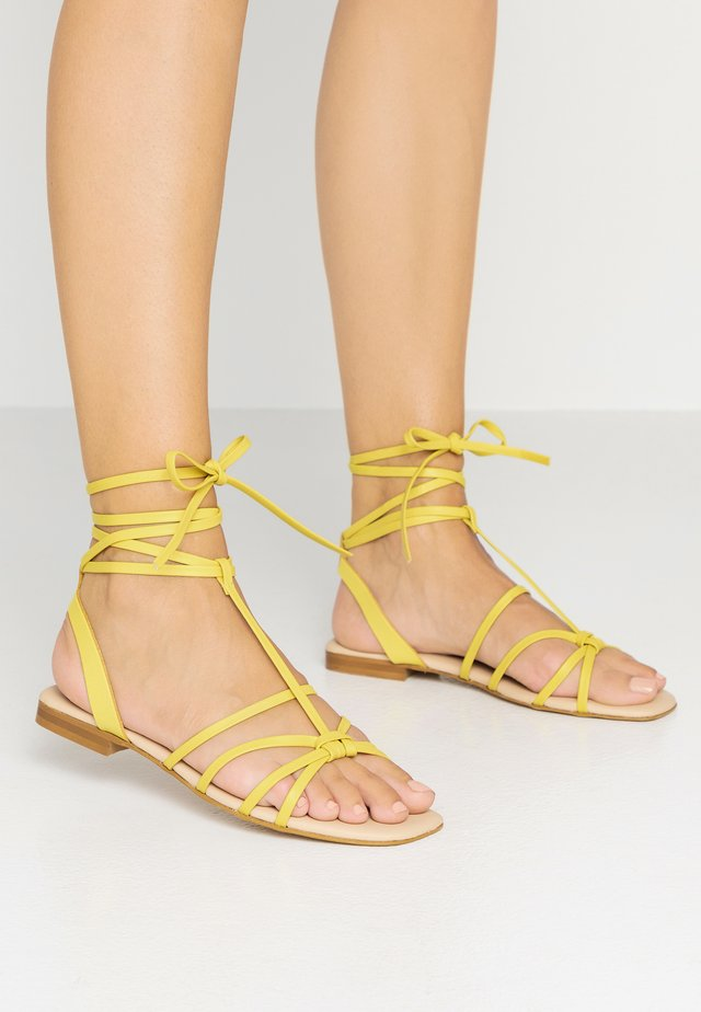 Riemensandalette - yellow