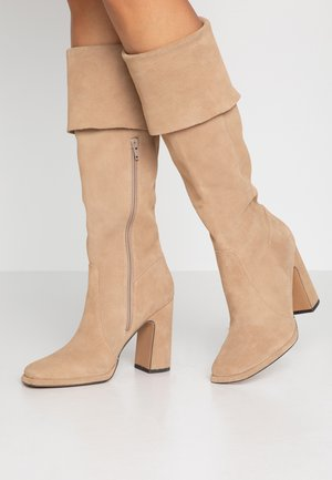High heeled boots - beige