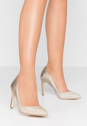Klassiska pumps - gold