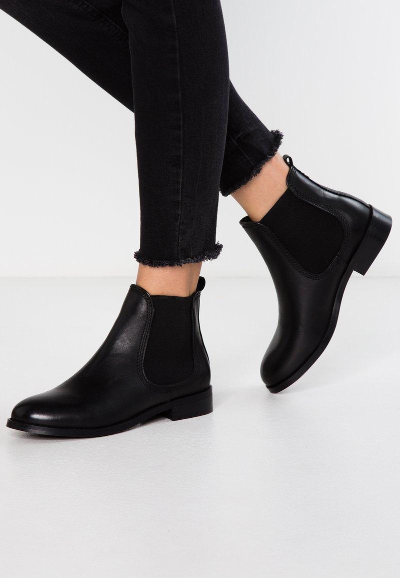 KIOMI - Ankelboots - black