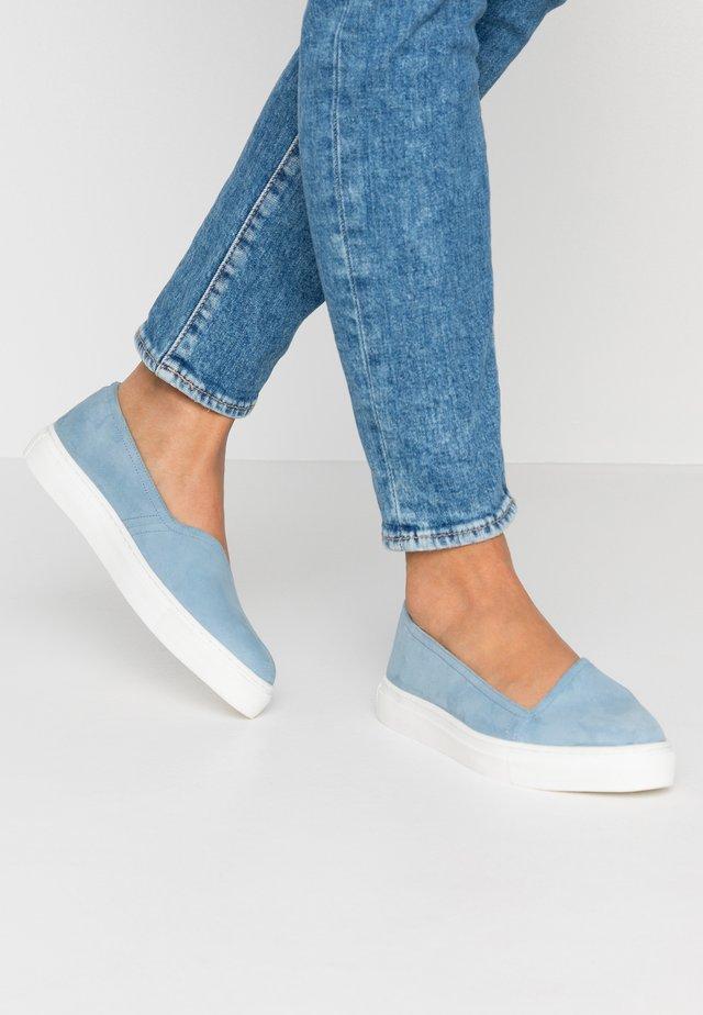 Slip-ons - light blue