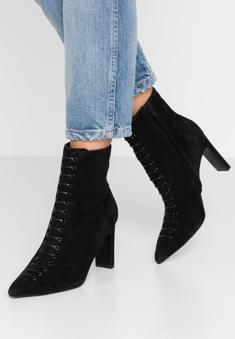 KIOMI - Kotníkové boty - black