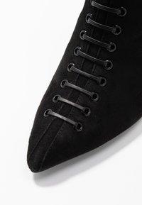 KIOMI - Kotníkové boty - black - 2