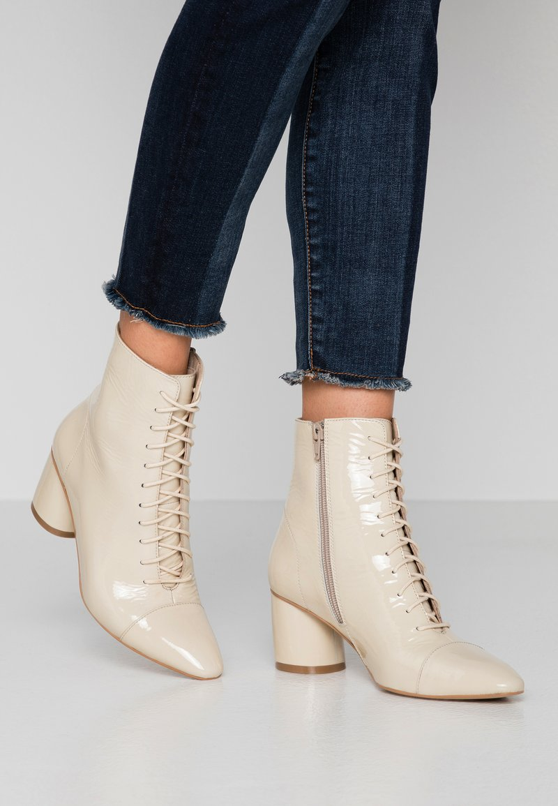 KIOMI - Lace-up ankle boots - offwhite