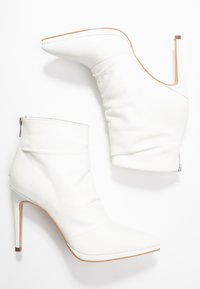 KIOMI - Classic ankle boots - white - 3
