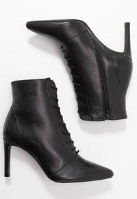 KIOMI - High heeled ankle boots - black - 3