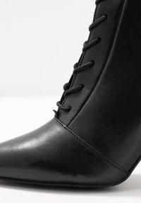 KIOMI - High heeled ankle boots - black - 2