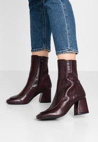 KIOMI - Classic ankle boots - dark red - 0