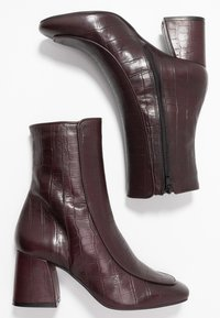 KIOMI - Classic ankle boots - dark red - 3