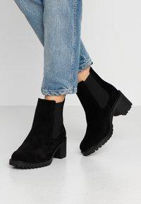 KIOMI - Classic ankle boots - black - 0