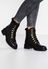 KIOMI - Lace-up ankle boots - black - 0