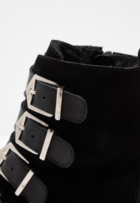 KIOMI - Winter boots - black