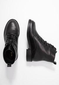 KIOMI - Winter boots - black - 3