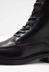 KIOMI - Winter boots - black - 2