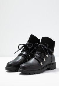 KIOMI - Vinterstøvler - black - 4