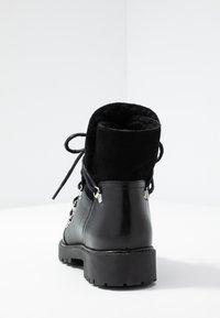 KIOMI - Vinterstøvler - black - 5